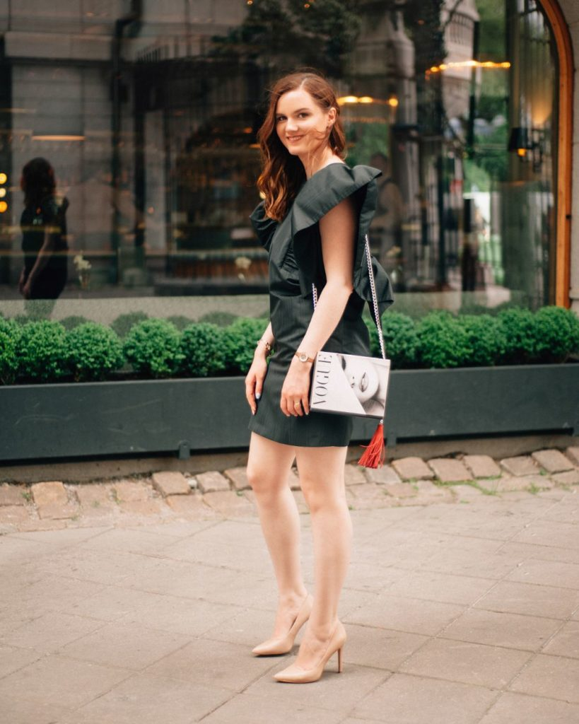 The WOW Closet founder Oksana Poliakova wearing MSGM Black Ruffle Shift Dress